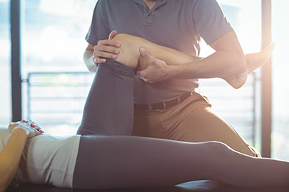 Physiotherapist performing a scapula mobilization